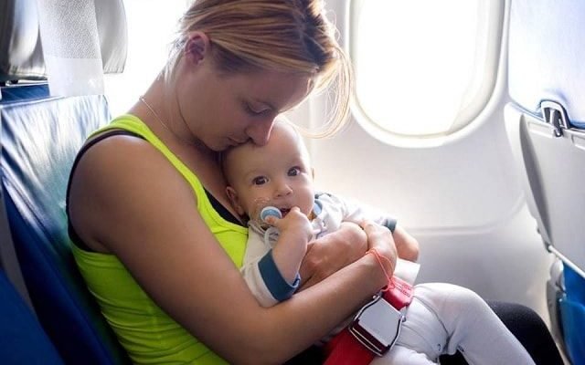 Tips to Get Your Baby to Sleep on the Plane min